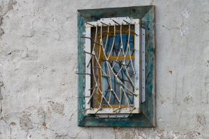 Window with polar bear guard spikes, Russian Far East.
