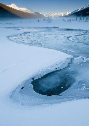 Ice along stream, Alberta.