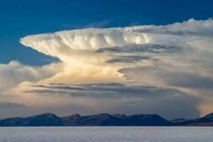 Thunderhead cloud over the Salar de Uyuni salt flats, Bolivia.