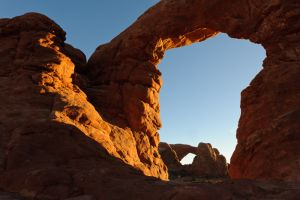 Looking through Turret Arch at North Window Arch, Arches National Park, Utah.