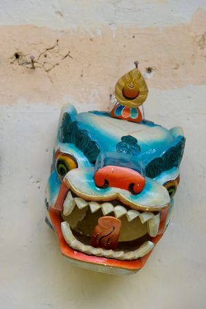 Ceremonial mask on wall, Thimphu, Bhutan.