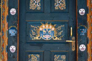 Painted door at Sangchhen Dorji Lhuendrup lhakhang nunnery, near Punakha, Bhutan.