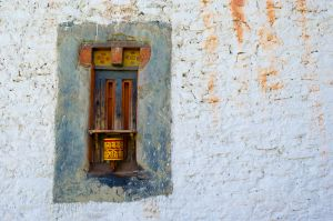 Prayer wheel in wall, Jakar, Bhutan.