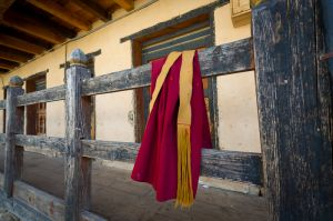 Railing and monk's robe at Kurjey Lhakhang temple, in Bumthang, Bhutan.
