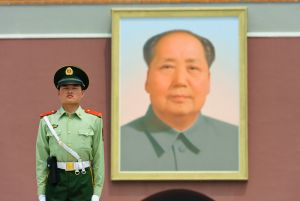 Police guard and portrait of Mao at the Forbidden City's Gate of Heavenly Purity.