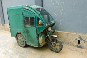 A slightly battered tuk tuk, Beijing.