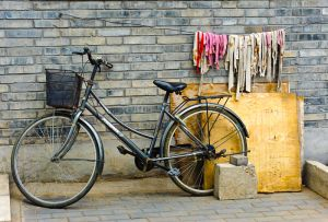Bicycle and wall, in one of the hutongs (old alleyways) in Beijing.
