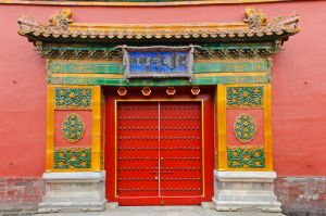 Brightly painted doorway in the Forbidden City, Beijing.