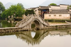 The South Lake and bridge, Hongcun village in Yixian county, Anhui province.