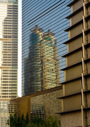 Reflection of building, in windows of highrise office, Shanghai.