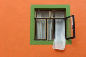 Brightly painted house and window, Guanajuato, Mexico.