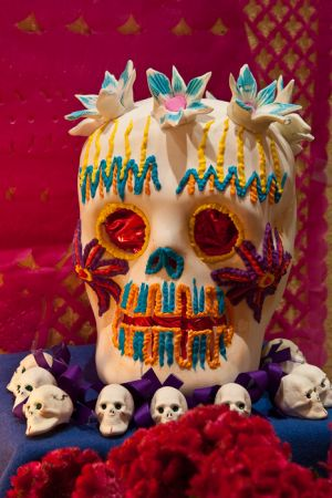 "Dead of the Dead sugar skull on ""ofrenda"" alter, San Miguel de Allende, Mexico."