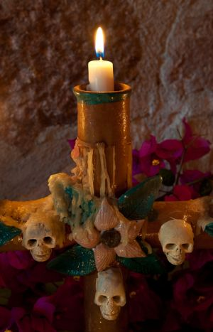 "Candle on Day of the Dead ""ofrenda"" alter, San Miguel de Allende, Mexico."