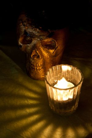 "Skull and candle on Day of the Dead ""ofrenda"" alter, San Miguel de Allende, Mexico."