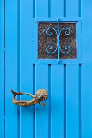 Blue door with mermaid handle. Guanajuato, Mexico.