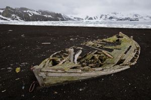 Old dory boat on shore at Whalers Bay, Deception Island.