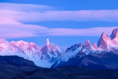 Lenticular clouds at dawn over Mt. Fitzroy and Cerro Torre, Argentina.