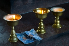 Butter lamps and offering, Bhutan.